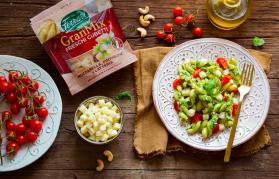 Pasta al pesto di rucola, pomodorini e anacardi